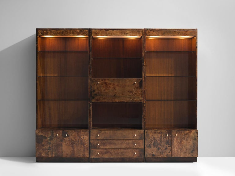 Cabinet, wood lacquered goatskin, Italy, 1940s  This Italian chest is highly elegant and refined. The panels, handles, and patterned doors are all exquisitely produced. There are closed compartments such as drawers, doors and shelves. In the top of