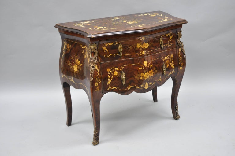 Pair of Italian Inlaid French Louis XV Style Bombe Nightstands by Roma Furniture in Walnut Briar. Nightstands feature beautiful floral inlay, bronze ormolu, shapely bombe form, two dovetailed drawers, cabriole legs, and stunning walnut briar wood