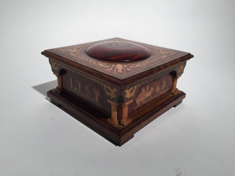 Exotic mahogany and satinwood inlaid jewelry box from the first half of the 20th century, 1930-1950. Elegant neoclassical shape with original blue silk tufted lining.