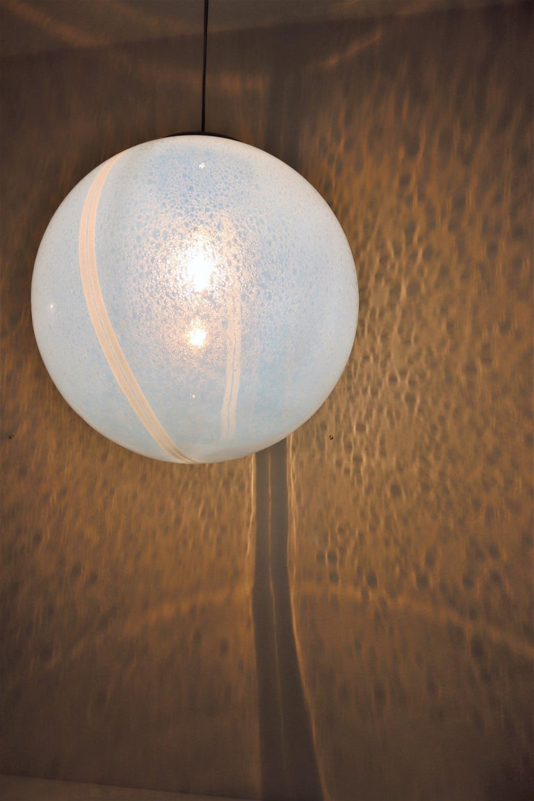 Attention shadow hunters ! This pendant lamp is made for you ! Gorgeous and big glass sphere pendant lamp with stunning iridescent glass with countless inside bubbles and 2 shiny white stripes around the glass. The bubbles and the two stripes cast