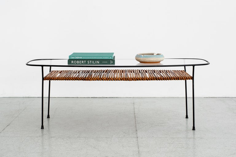 1960s Italian iron and bamboo coffee table with glass top, iron frame and bamboo shelf. Oblong shape, and impressive in scale.