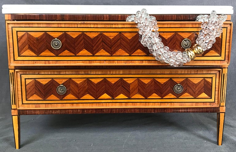Italian jewelry box. Neoclassical style miniature chest of drawers fit for jewels.  A scaled replica of a Louis XVI boxwood, palissander, rosewood and ebony inlaid commode with antique Carrara marble top and velvet lined drawers finished on all