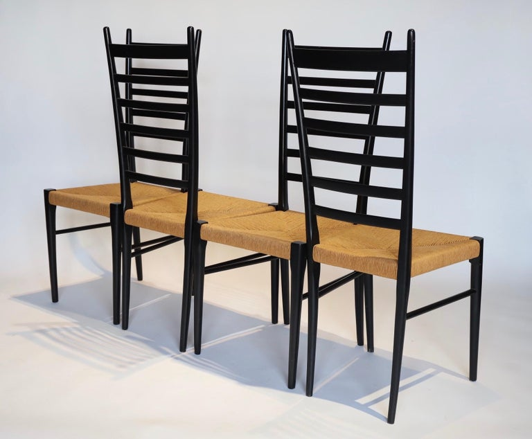 Stunning set of 4 black ladder back dining chairs with jute seats in the style of Gio Ponti, made in Italy. Photographed with Eames DCM for scale.