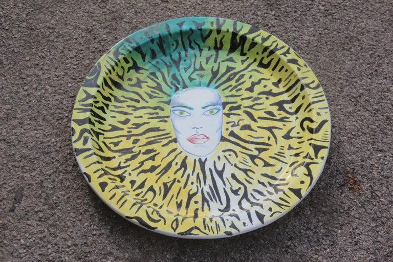 Italian large round ceramic dish plate from the 1980s. Multicolored face yellow green.