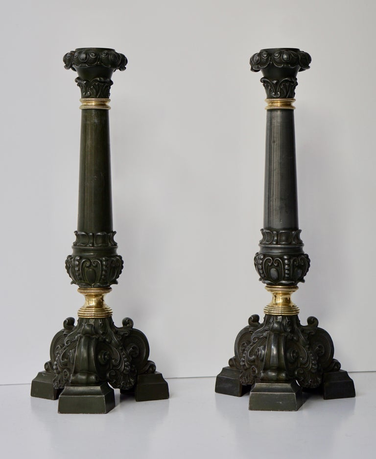 Italian late 19th century pair of antique brass candleholders. This pair of antique brass candleholders was handcrafted by Italian artisan.  These objects donate a glamour and untimeless touch to the table set up.