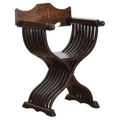 Italian Late Renaissance Walnut Folding Savonarola Chair, 17th Century