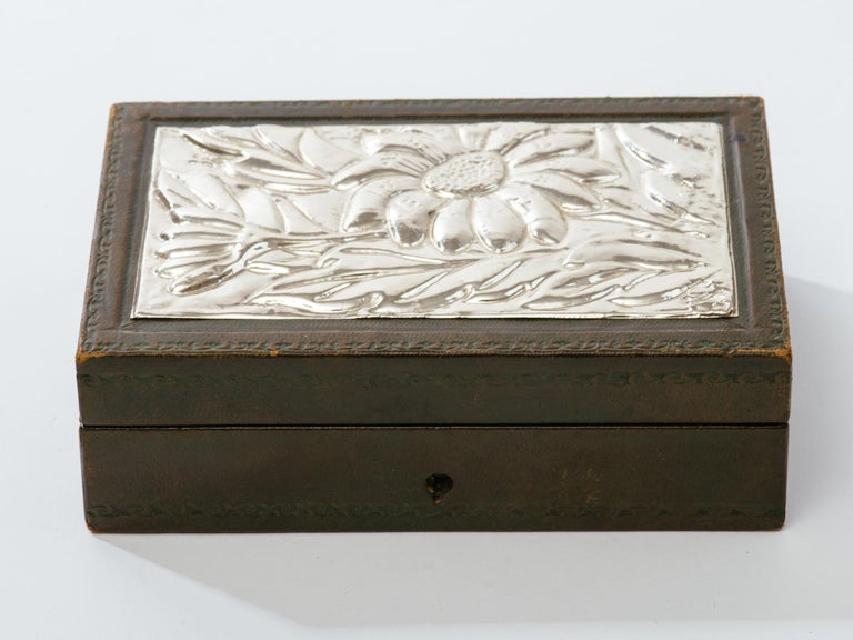 Italian tooled leather jewelry box with hand-wrought sliver repousse top. Hallmarked 920  on corner of silver top. Missing key, Italy, circa 1950s.