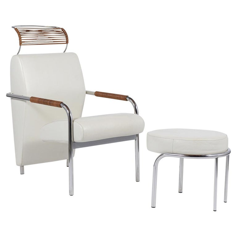 This midcentury leather easy lounge chair and ottoman by Andrea Branzi for Zanotta is handcrafted out of a steel & wood combination and is in great condition. This unique club chair features a sleek modern design, the head & tubular armrest are