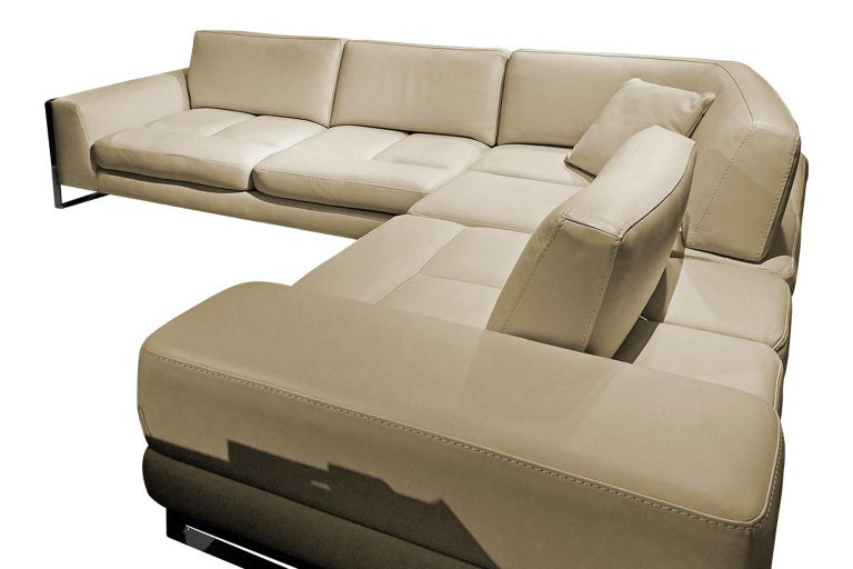 Leather sectional with 3 adjustable back cushions. Upholstered in high grade leather with tone-on-tone stitching. Polished chrome details.