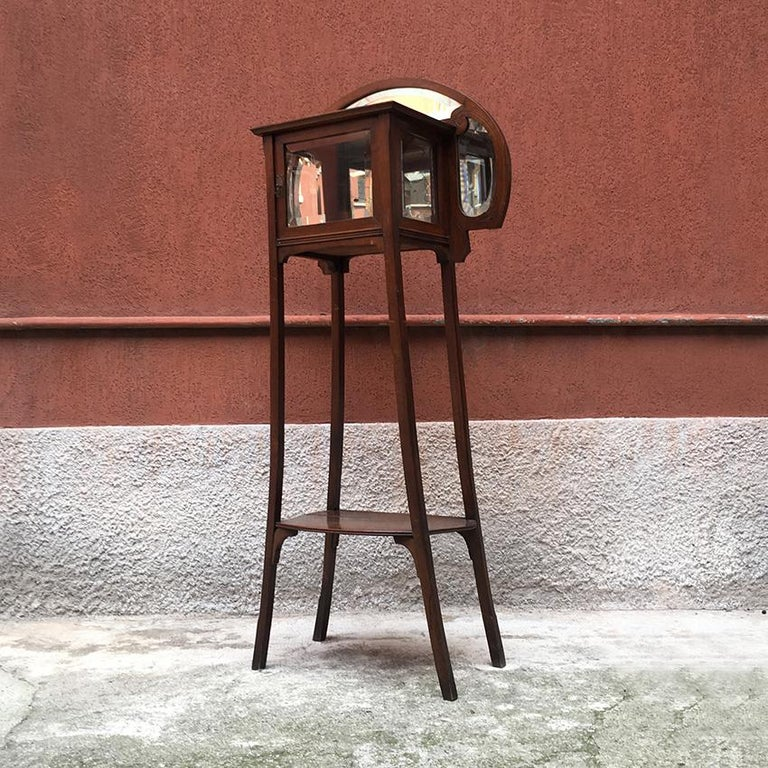 Italian liberty walnut étagère with showcase, late 1800-early 1900. Liberty etagere in walnut equipped with showcase and grinding mirror. Small container mirrored module in the internal part as well as shelf in the lower part of the structure.