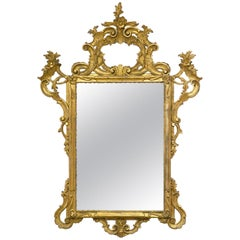 Italian Louis XV Style Carved Giltwood Mirror with Decorative Crest Mirror