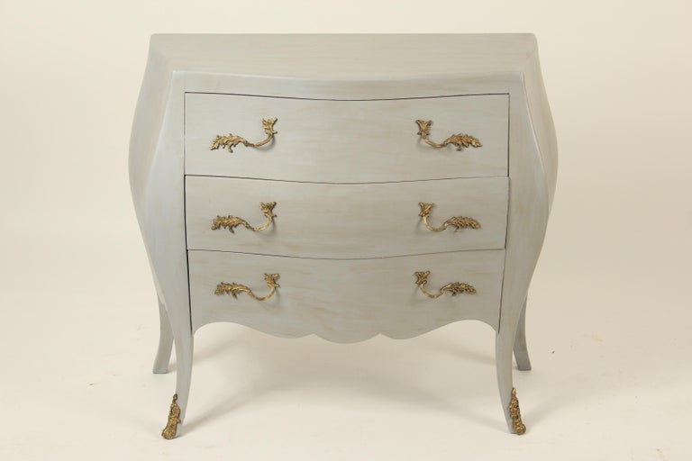 Italian Louis XV style painted bombe chest of drawers with bronze drawer pulls and bronze sabots, circa 1980s. The paint is 21st century.