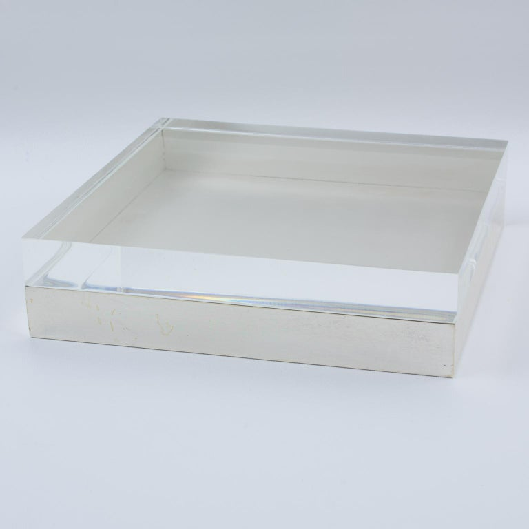 Elegant 1970s modernist decorative box reminiscent of Gabriella Crespi's work. Large geometric shape with silverplate base and thick crystal clear Lucite lid. No visible maker's mark Measurements: 7.88 in. wide (20 cm) x 7.88 in. deep (20 cm) x 2