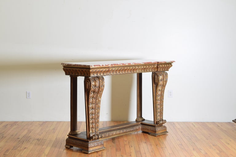Having a shaped top with notched corners and a marble top, the front supports are large carved scrolls the bottom level mimicking the top in shape, second half of the 19th century.