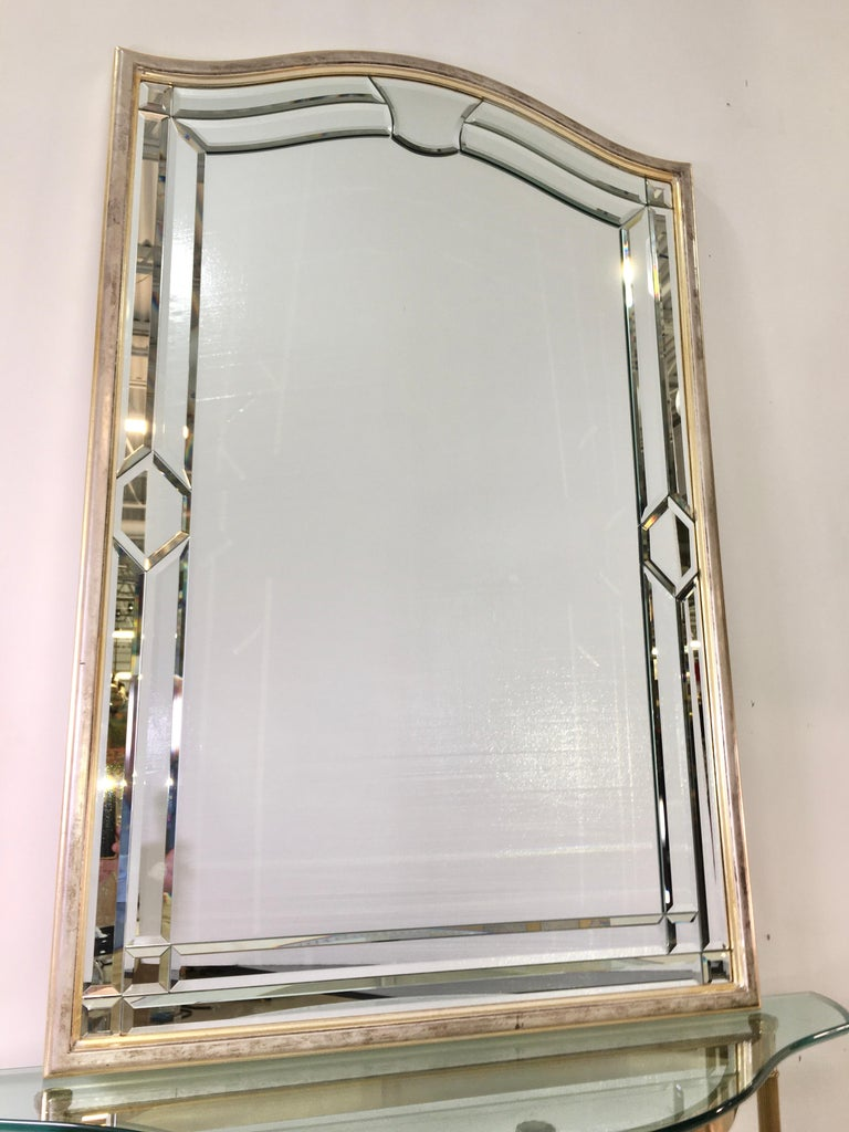 Vintage wall mirror made of 24 pieces of individual beveled glass in wood frame with silver leaf and mecca finish. Label on verso reads decorative crafts, Inc. Handcrafted imports. Made in Italy. 10386/641.