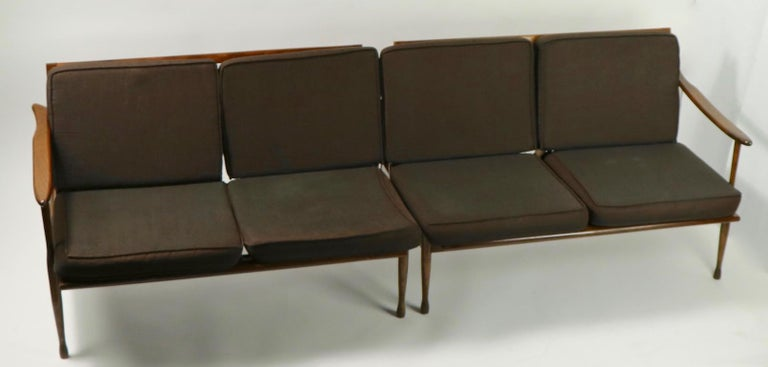 Interesting sectional sofa marked made in Italy that exhibits obvious reference to Danish modern design. Open arm frames support loose cushion upholstery, original fabric which shows normal cosmetic wear consistent with age. This is a sectional