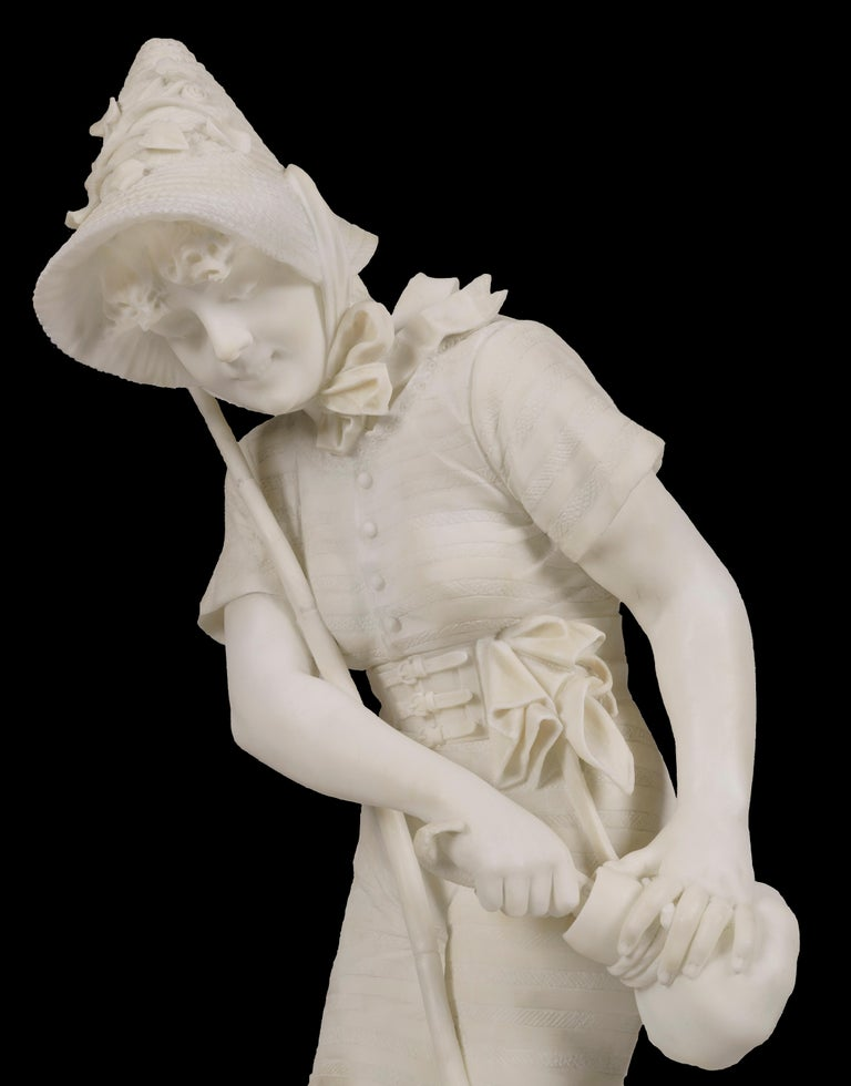 Pescatrice By Pietro Bazzanti  Carved from lustrous alabaster and rising from a shaped naturalistic base, the figure of the fisherwoman straddling her fishing rod as she saves a fish in her satchel. Her costume and facial features of exceeding