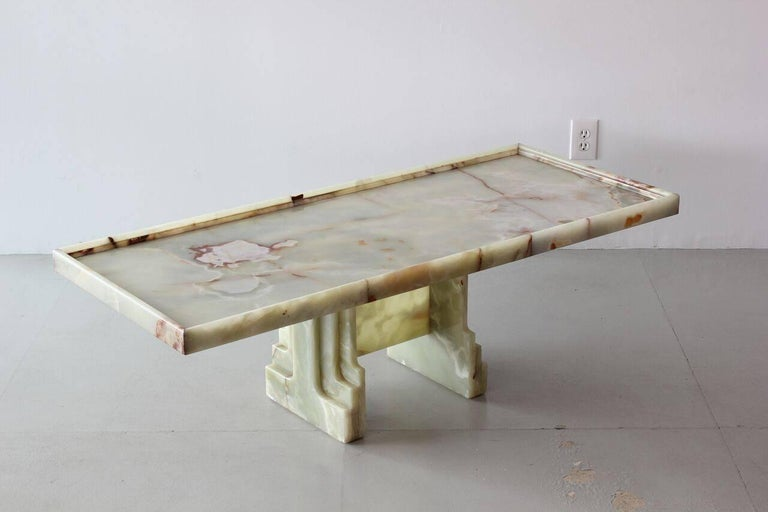 Gorgeous Italian marble coffee table with carved base and floating top.
