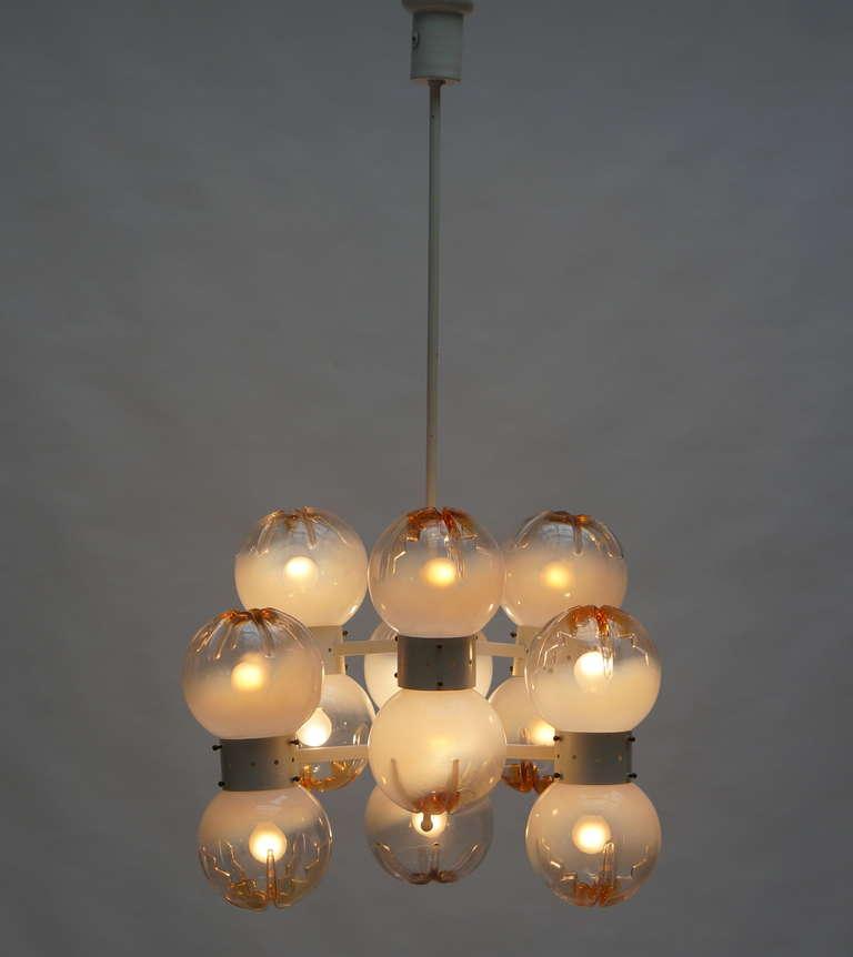 Italian AV. Mazzega chandelier with 12 globes. Measures: Diameter 60 cm, height 110 cm.