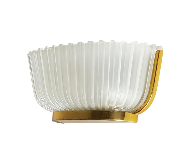 Vintage Italian sconce made from metal, brass and molded glass shade. Lamp features 2 light holders (E27 measure) and remains in very good condition: one small chipping on the glass as showed in picture.