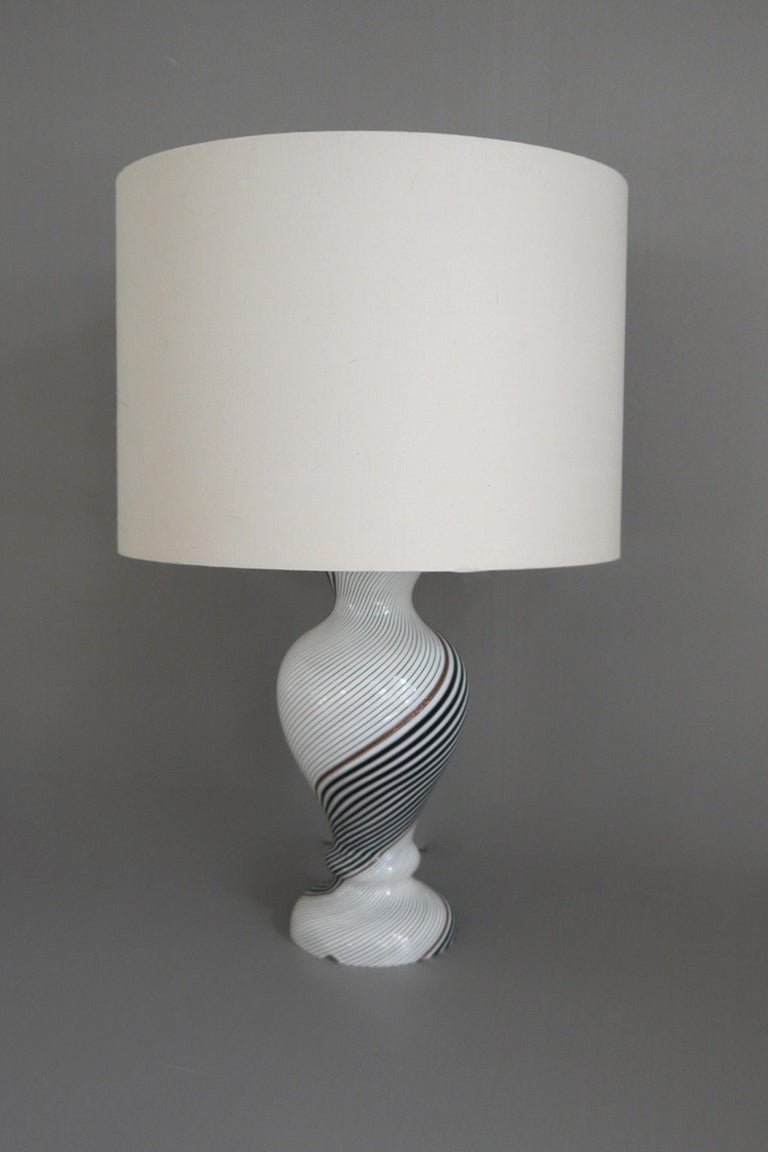 A mezza filigrana bianca nera technique blown glass lamp base by Dino Martens in white and black mezza filigrana with flashes of avventurine. Produced in 1957 when Martens was working with Aurelian Toso. There is a cable runner to ensure the