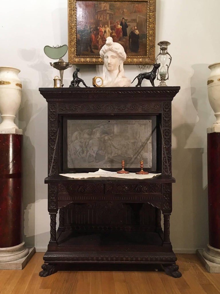 A Tuscan carved solid walnut wood fall front writing cabinet, called