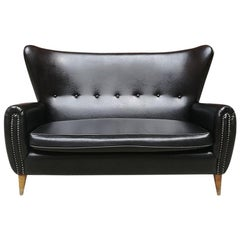 Italian Mid-Century Black Leather Sofa with Armrests and Wooden Legs, 1950s