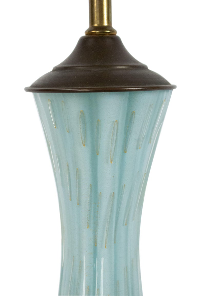 Italian (mid-20th century) blue glass fluted and shaped table lamp with a gold bubble decoration.