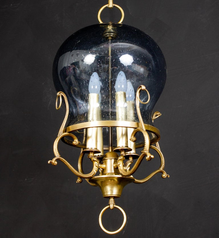 Amazing Italian midcentury brass and light blue Murano glass lantern or pendant. Four E 14 light bulbs. We can wire for your country standards.