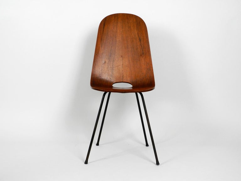 Extremely rare midcentury chair by Vittorio Nobili. Made in Italy. Made of thick plywood with teak veneer. Beautiful Italian Minimalist design from 1955 with beautiful teak wood grain. Legs made of solid iron. 100% original condition all parts
