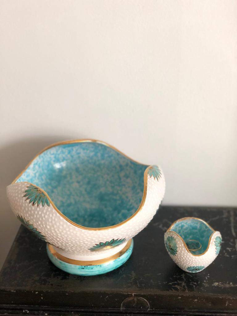 A stunning Italian set by Ars Deruta composed of an organic shaped textured ceramic decorative bowl with blue inside and gold rims highlighted by beautiful flower motifs. The second piece is an original candleholder in the same style. Italy.