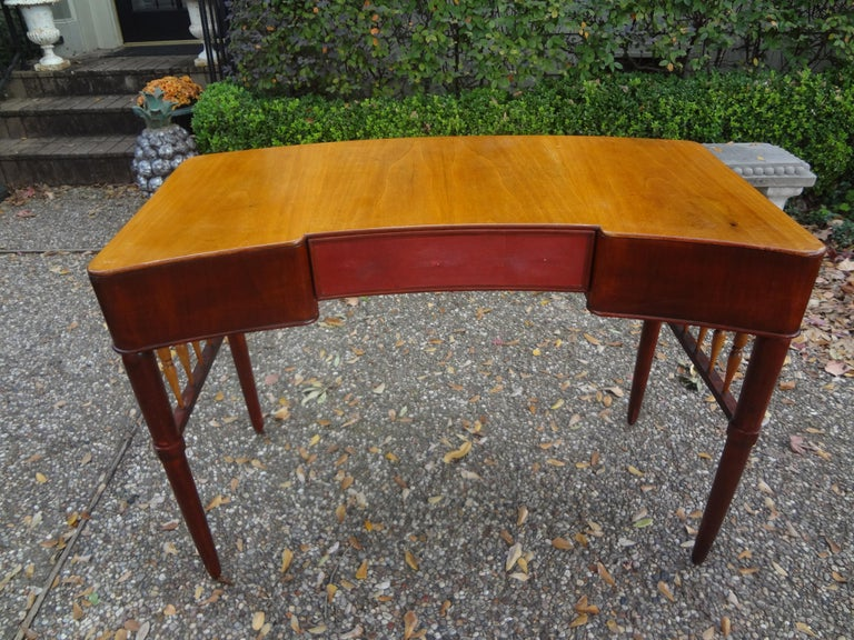Stunning Italian midcentury desk or writing table attributed to Paolo Buffa. This sculptural desk has beautifully tapered legs, two side drawers and a shagreen covered center drawer. This lovely piece is finished on all sides could be floated in a
