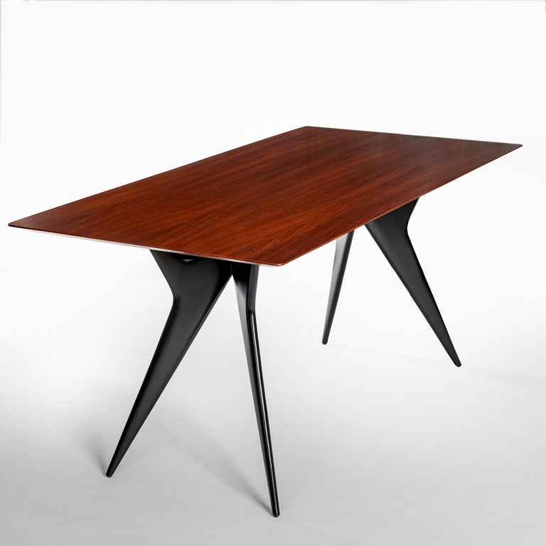 The dining table or desk by the architect and designer Ico Parisi is from the early 1950s produced by MIM - Mobili Italiani Moderni Characteristics: flared, tapered leg guides, table top only 4 mm towards the edge - the whole object has no sharp