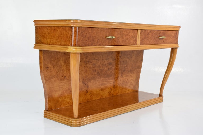 Mid-Century Italian art deco style dresser or vanity composed of bird's-eye maple veneer, beechwood frame, a glass tabletop with a sheath of colored paper underneath and a detachable vintage mirror. The console has two drawers with solid brass