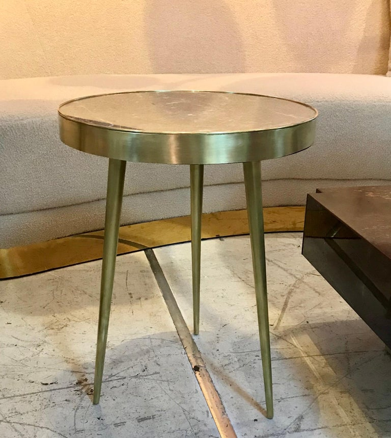 A pair of taupe grey marble topped side tables with tapered brass legs, circa 1960s, Italy.