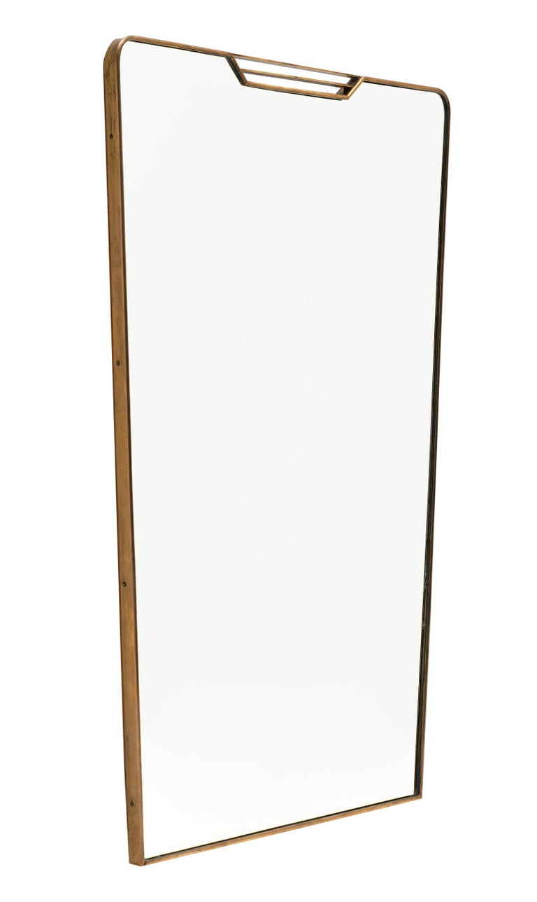Midcentury Italian mirror in the style of Paolo Buffa. This vintage piece is all original, with a brass structure and tapered shape. A great design!