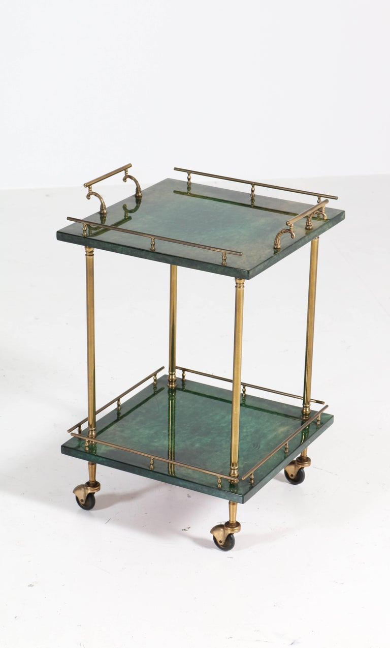 Elegant and rare Mid-Century Modern bar cart or side table.