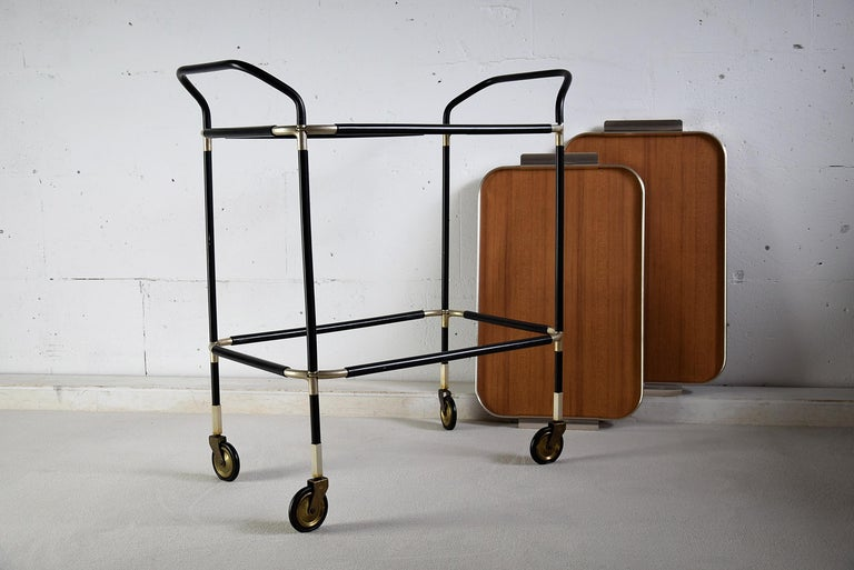 Stylish and elegant Italian 1960s bar trolley with two detachable serving trays. The trolley is in great condition as can be seen in the images. The trolley will be shipped overseas insured in a custom made wooden crate. Cost of insured transport