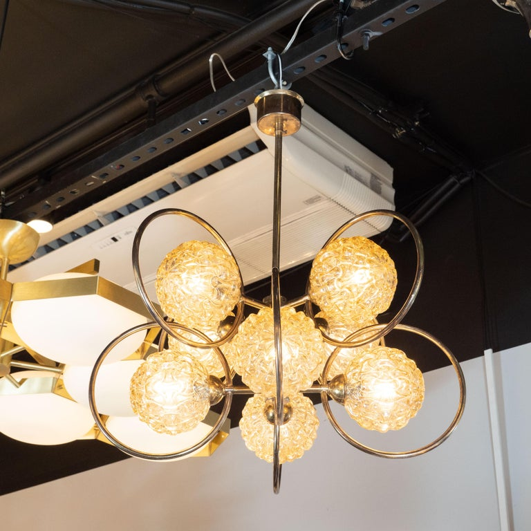 1970s Italian Mid-Century Modern Brass and Champagne-Colored Textural Glass Chandelier For Sale