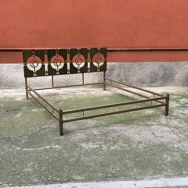 Italian Mid-Century Modern brass double bed with decorative headboard, 1960s Double bed in brass, headboard with repeated decorative motif. Drawing by Frigerio Di Desio, 1960s  Good condition.  Measurements 175 x 200 x 91 H cm.