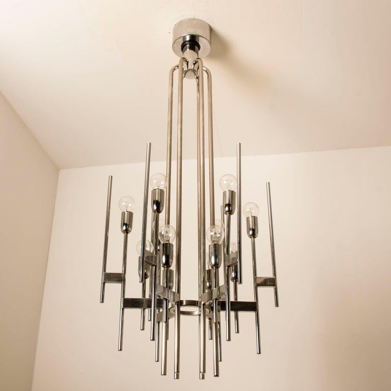 Italian Mid-Century Modern minimal sculptural chrome chandelier by Gaetano Sciolari, Italy, 1960s. Beautiful Art Deco inspired design. Minimalistic design executed with a taste for excellence in craftsmanship.  Cleaned and well-wired, in full