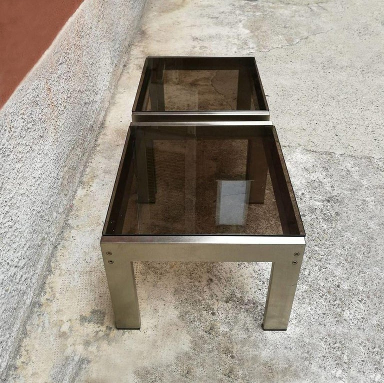 Italian Mid-Century Modern coffee tables by Gae Aulenti for Zanotta, 1970s Two coffee tables in satin steel and smoked glass designed by Gae Aulenti for Zanotta. Tvolini with a timeless elegance Excellent general conditions Measures: 50 x 50 x