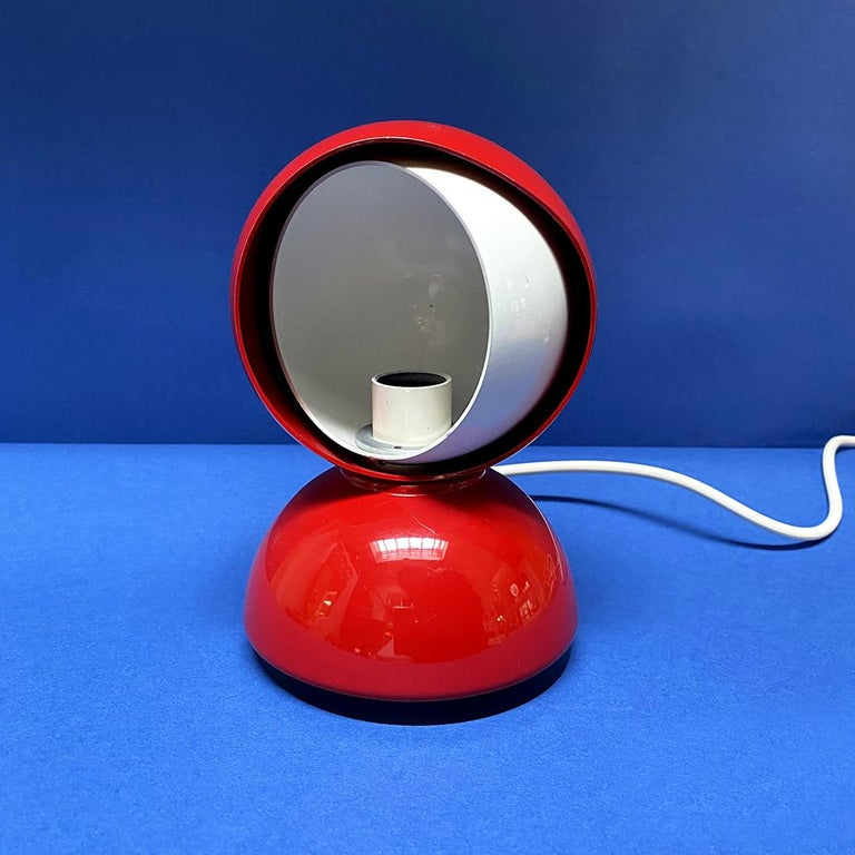 Italian Mid-Century Modern Eclissi lamp by Vico Magistretti for Artemide, 1967 Eclissi lamp in red and white metal on the inside and swivel, its internal lampshade in fact thanks to the rotation allows you to adjust the light source and can provide