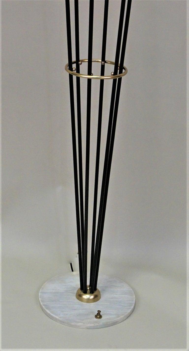Italian Stilnovo floor lamp in black lacquer, bronze, marble base and opaline glass.