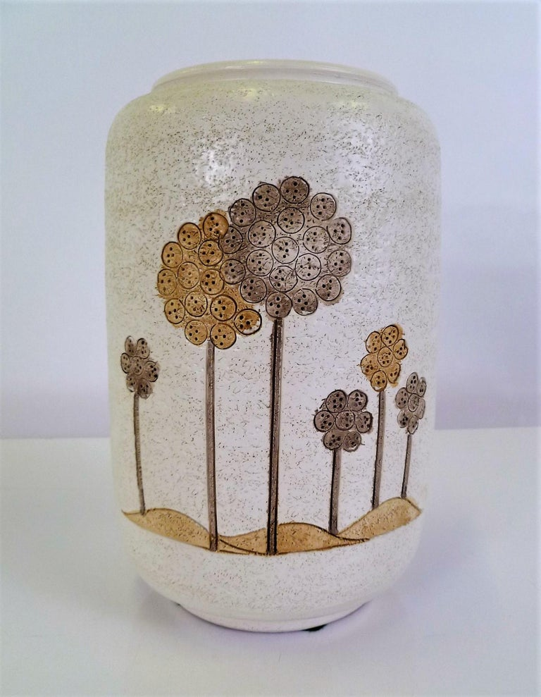 Late 1960s-early 1970s Italian modern hand thrown ceramic vase with a light textured finish. More than likely produced by Ceramiche Campione (1950-1974) for New York retailer, Ardalt. The decoration is very 1960s with stylized trees or long stem