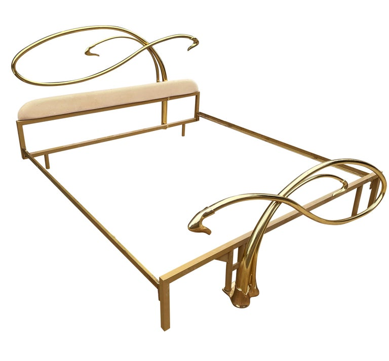 A touch of glam from the 1970s. A stunning brass king size bed with headboard, footboard, and side rails. This heavy duty brass bed was imported from Italy, circa 1970s.