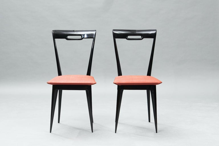Italian Mid-Century Modern Italian dining chairs in ebonized wood upholstered in the original pegamoid, set of six.