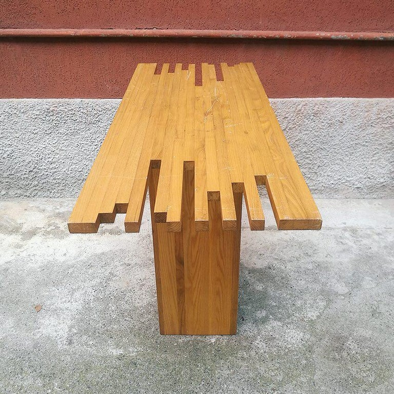Italian Mid-Century Modern light wood console, 1970s Console in light wood worked at the ends of the top. It really is a versatile piece of furniture. Good conditions.