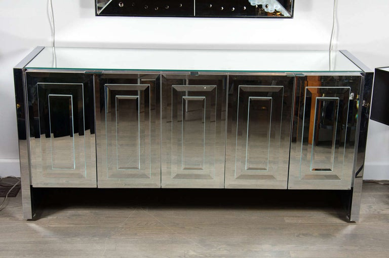This stunning Mid-Century Modern mirrored and chrome sideboard was realized by the celebrated design firm Ello, in Italy, circa 1970. An iconic example from their