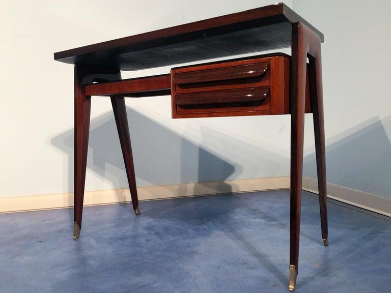 Stylish Italian Mid-Century Modern petite desk in teak from the 1950s elegantly named